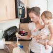 Mother Making A Sandwich For His Baby Girl — Stockfoto