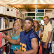 Young Adults In A Library — Stock Photo