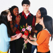 Girls Surrounding A Boy Who Is Holding Flowers — Stock Photo #31943407