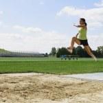 Woman Doing Long Jump — Stock Photo #31943469