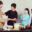 Stock Photo: Teenagers Serving Meal To Man