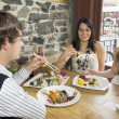 Three Friends At A Sushi Restaurant — Stock Photo
