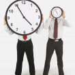 Businessmen Holding Clocks In Front Of Their Faces — Foto Stock #31943821
