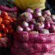 Mesh Bags Full Of Onions Tomatoes And Other Vegetables — Stok fotoğraf