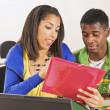 Stock Photo: Two Students In Classroom With Laptop