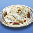 Stock Photo: AmericMoney In Church Offering Plate