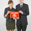 Two People Holding A We'll Work For Food Sign — Stock Photo