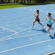 Stock Photo: Runners Racing On Race Track