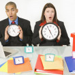 Stock Photo: Colleagues Holding Clocks