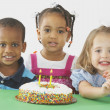 Three Children With A Birthday Cake — Stock Photo