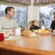 Family Smiles At Breakfast Table — Stock Photo