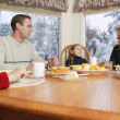 Stock Photo: Family Smiles At Breakfast Table