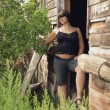 Pregnant Woman In An Old Wooden Cabin — Stock Photo