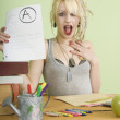 Stock Photo: Student Holding Paper With An A Grade