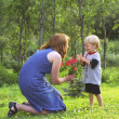 Mother And Son With Flowers In Park — Stock Photo
