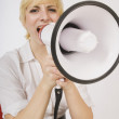 Stock Photo: Blond Yelling Into Bullhorn