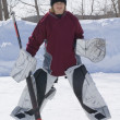 Stock Photo: Boy Playing Goalie In Ice Hockey Game