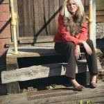 Woman Sitting On Broken Steps — Stock Photo #31945639