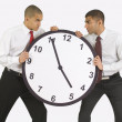 Stock Photo: Businessmen Fighting Over A Clock