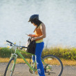 Cyclist Checking Her Phone — Stock Photo #31945791