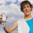 Young Man Outdoors With A Bottle Of Water — Stock Photo