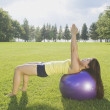 Woman Doing Yoga In A Park With A Pilates Ball — Stock Photo