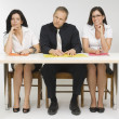 Three People Sitting At Desk — Stock Photo