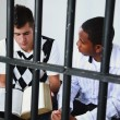 Young Man Reads The Bible To Another Young Man In Jail — Stock Photo #31946449