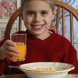 Young Boy With Food At Breakfast Table — 图库照片