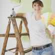 Woman Standing On Ladder With Paint Swatches And Roller — Stock Photo