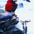 Cyclist Taking A Break At Small Waterfalls — Stock Photo
