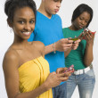 Three Teenagers Texting — Stock Photo #31946701
