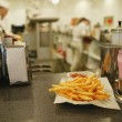Stock Photo: French fries on plate with napkin