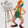 Clown Pointing At A Poster Of A Car Advertisement — Foto Stock