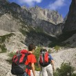 Male Hikers Climbing With Backpacks Up The Dolomites. Veneto, Italy — Stock Photo