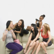 Friends Sitting On Couch — Stock Photo #31947011