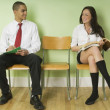 Stock Photo: Two People Waiting On School Chairs