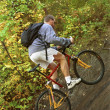 Man Riding Trail Bike In Forest — Stock Photo