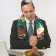 Businessman Eating Birthday Cake At His Desk — Stok fotoğraf