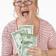 Excited Woman Holding Money — Stock Photo