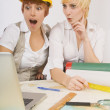 Two Surprised Women Looking At Laptop — Stock Photo