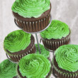 Stock Photo: Green Icing On Chocolate Cupcakes For Saint Patrick's Day