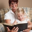 Grandmother Reading The Bible To Her Granddaughter — Stock Photo
