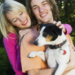 Couple Holding A Jack Russell Terrier — Stock Photo