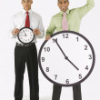 Stock Photo: Businessmen Holding Clocks