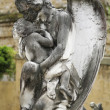 Statue Of Angel Holding Baby — Stock Photo