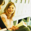 Students Sitting In Hallway — Stock Photo