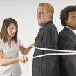 Woman Tying Two Businessmen Together With A Rope — Stock Photo