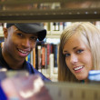 Young Man And Woman In A Library — Stock Photo