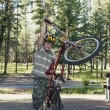 Boy Plays With His Bike In A Campground — Foto de Stock